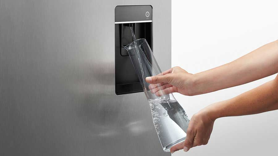 Easy water and ice dispensing with Fisher & Paykel RF610ADUB5 french door refrigerator